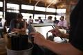 Preparing the bill at a restaurant using a touch screen till