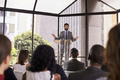 Hispanic man gesturing to audience at business seminar - PhotoDune Item for Sale