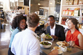 Group Enjoying Business Lunch In Delicatessen - PhotoDune Item for Sale