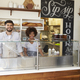 Mixed race couple behind the counter at a sandwich bar - PhotoDune Item for Sale