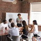 Mature Businesswoman Addressing Boardroom Meeting - PhotoDune Item for Sale