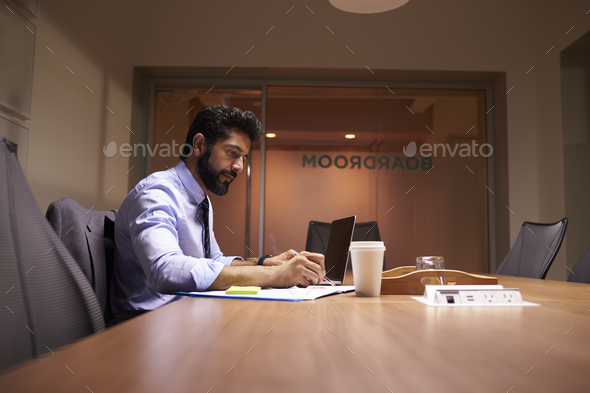 Middle aged Hispanic businessman working late in an office - Stock Photo - Images