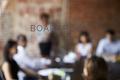 View Of Meeting Through Glass Door Labelled Boardroom - PhotoDune Item for Sale