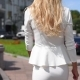 Girl Is Walking Around the Square in a White Business Suit - VideoHive Item for Sale