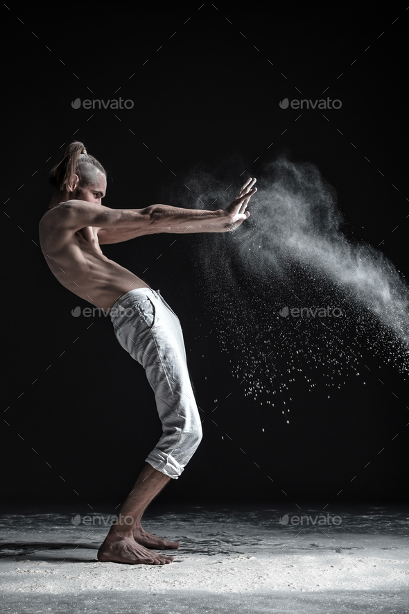 Portrait of caucasian young man wearing white sport pants doing yoga or pilates exercise. - Stock Photo - Images