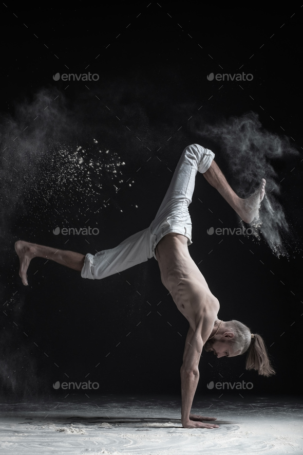Flexible yoga man doing hand balance asana vrischikasana. - Stock Photo - Images
