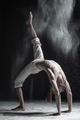 young man doing yoga. Urdhva Dhanurasana. - PhotoDune Item for Sale