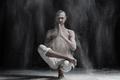 Young man doing yoga. Half Lotus Toe Balance - PhotoDune Item for Sale