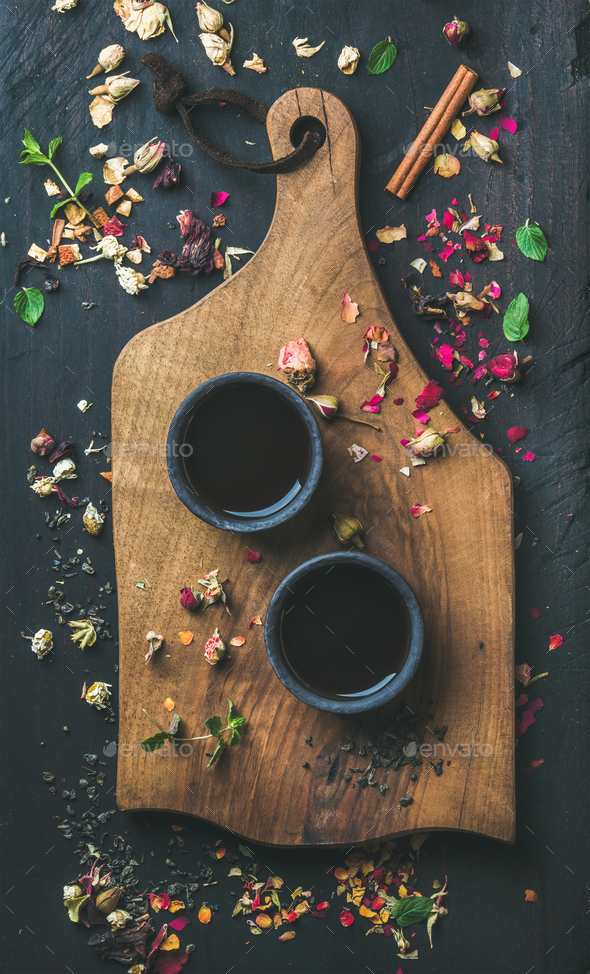 Chinese black tea in black stoneware cups on wooden board - Stock Photo - Images