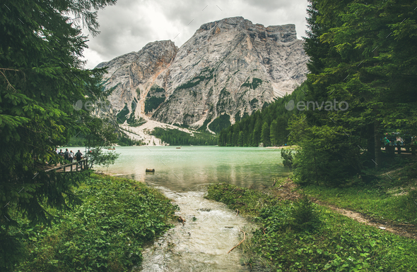 Mountain Lake in Valle di Braies surrounded by forests - Stock Photo - Images