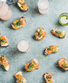 Crostini with smoked salmon and grapefruit cocktails, top view, flat-lay