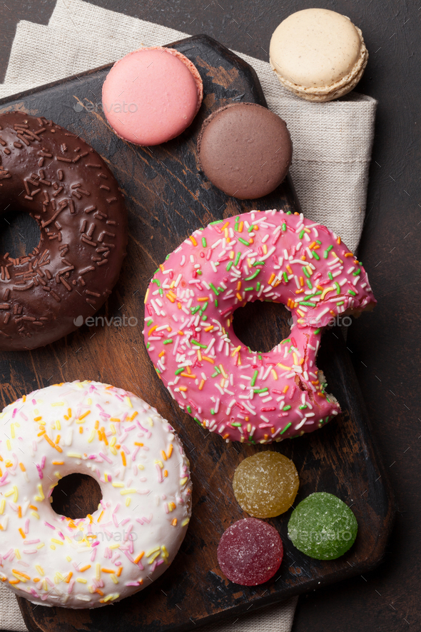 Colorful donuts and macaroons - Stock Photo - Images