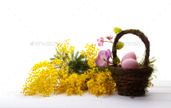 Bouquet of mimosa and easter eggs - Stock Photo - Images