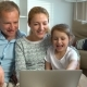 Family with Child Using Laptop Video Call Camera - VideoHive Item for Sale
