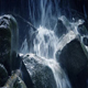 Moving Past Rocky Waterfall In The Mountains - VideoHive Item for Sale