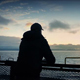Man Looks From Back Of Ship At Sunset - VideoHive Item for Sale