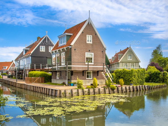 Historic waterfront houses along canal - Stock Photo - Images