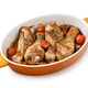 Baked chicken legs with tomatoes on white background - PhotoDune Item for Sale