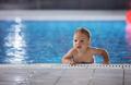 Little boy in indoor swimming pool