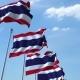Row of Waving Flags of Thailand Agaist Blue Sky