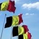 Row of Waving Flags of Belgium Agaist Blue Sky