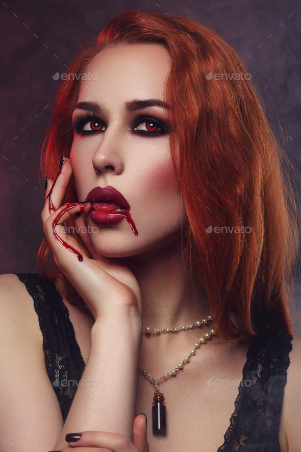 Beautiful vampire young woman - Stock Photo - Images