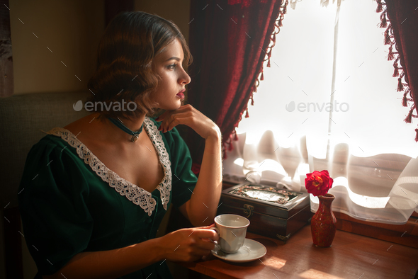Woman in vintage train, rich compartment interior - Stock Photo - Images
