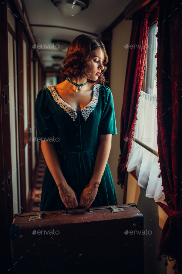 Railway journey woman in vintage train compartment - Stock Photo - Images