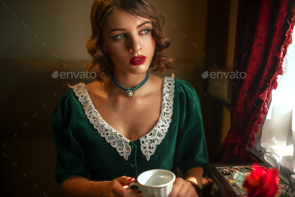 Woman travels on vintage train, rich compartment - Stock Photo - Images