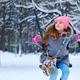 Charming little girl on swing in snowy winter - PhotoDune Item for Sale