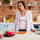 Cheerful woman cooking on modern kitchen - PhotoDune Item for Sale
