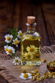 Chamomile oil with dry herbs