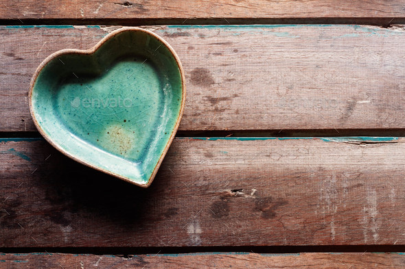 saucer of shaped heart on wood - Stock Photo - Images