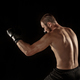 The young man kickboxing on black - PhotoDune Item for Sale