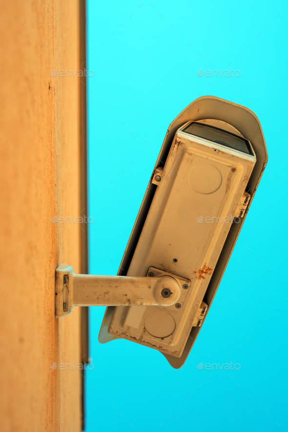 Low angle view of security camera housing - Stock Photo - Images