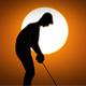 Male Caucasian Golfer In Sunset Silhouette