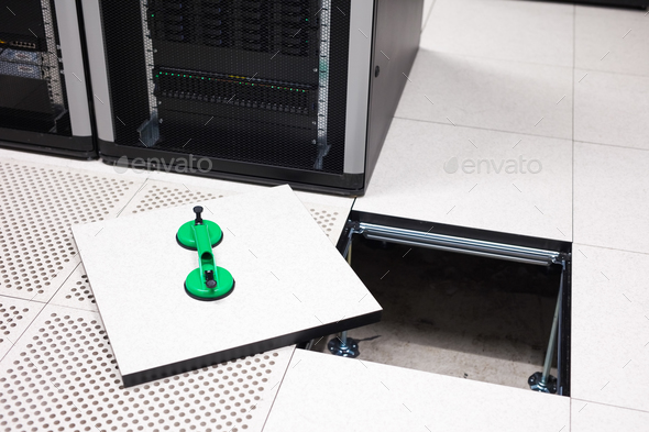 Lifted Floor Tile With Vacuum Suction Cups In Datacenter - Stock Photo - Images