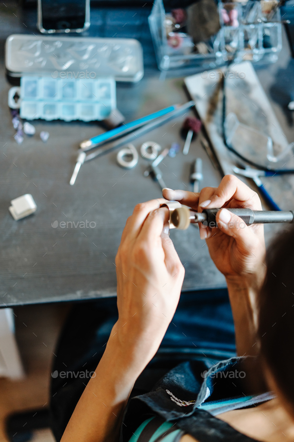The girl is engaged in jewelry business - Stock Photo - Images