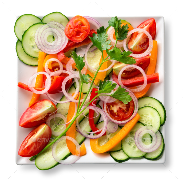 Salad of sliced raw fresh vegetables on white plate - Stock Photo - Images