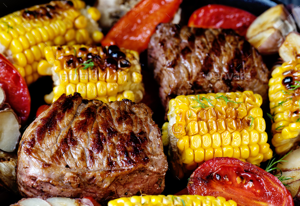 Food background of baked meat and corn - Stock Photo - Images