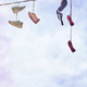 Old dirty shoes hanging on wire. - PhotoDune Item for Sale