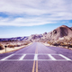 Vintage toned picture of a scenic deserted road. - PhotoDune Item for Sale