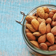 Almonds in a jar, space for text. - PhotoDune Item for Sale