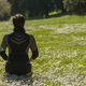 Man sitting on grass for meditation - PhotoDune Item for Sale
