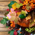 Fall decor with rowan and autumn leaves
