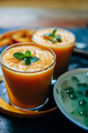 Orange smoothie with leaves of fresh mint