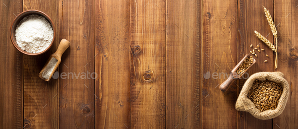 wheat grains on wooden background - Stock Photo - Images