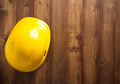 construction helmet hard hat on wood