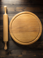 pizza cutting board at brown background