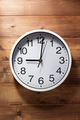 wall clock at wooden background - PhotoDune Item for Sale